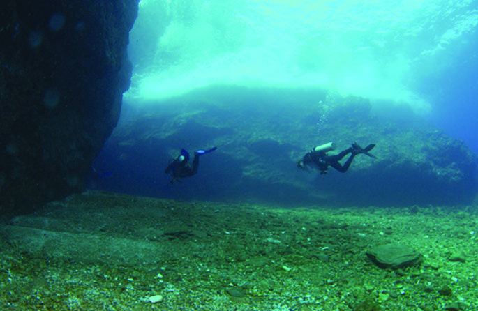 Two divers exploring Coral Reef in Okinawa