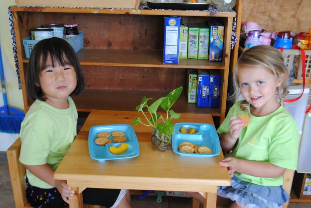 Children eating a snack at Sunshine Montessori School