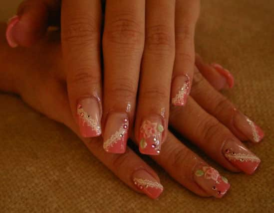 Woman's hands with pink rose nails