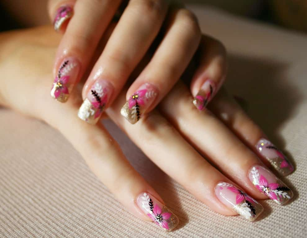 Woman's hands with pink flower nails