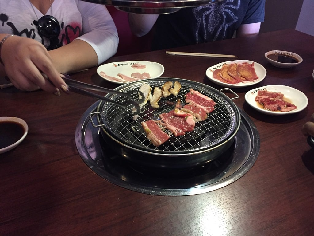 Grilling meat at Yakiniku Goen