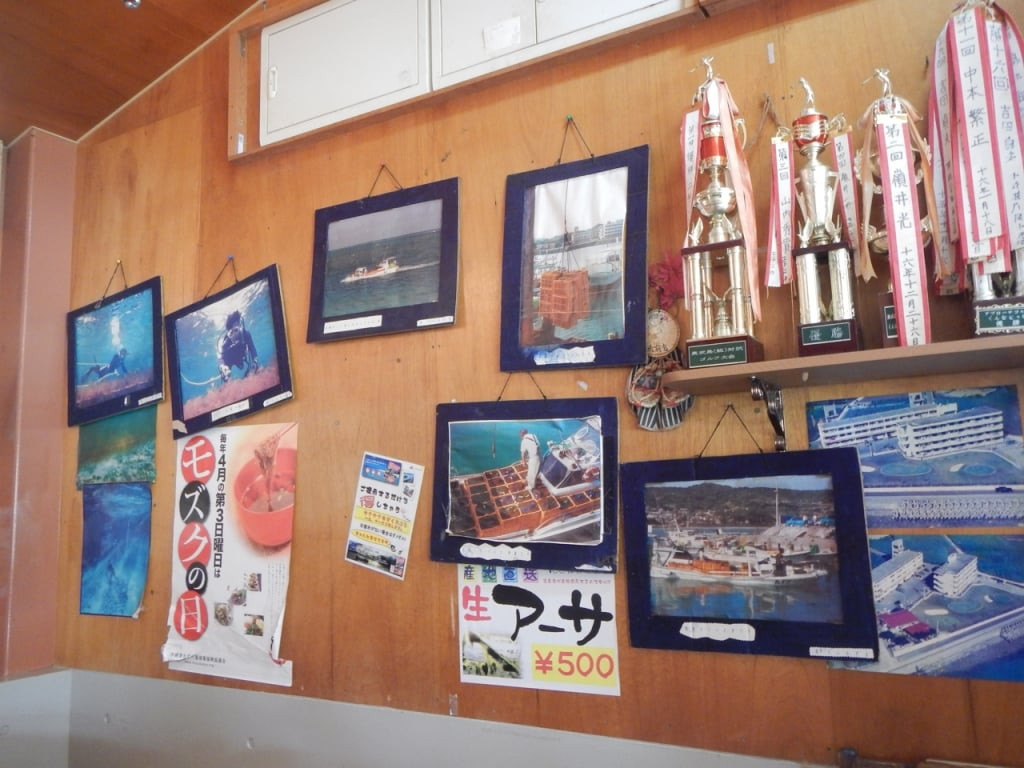 Photos on wall and trophies at Muzoku Soba