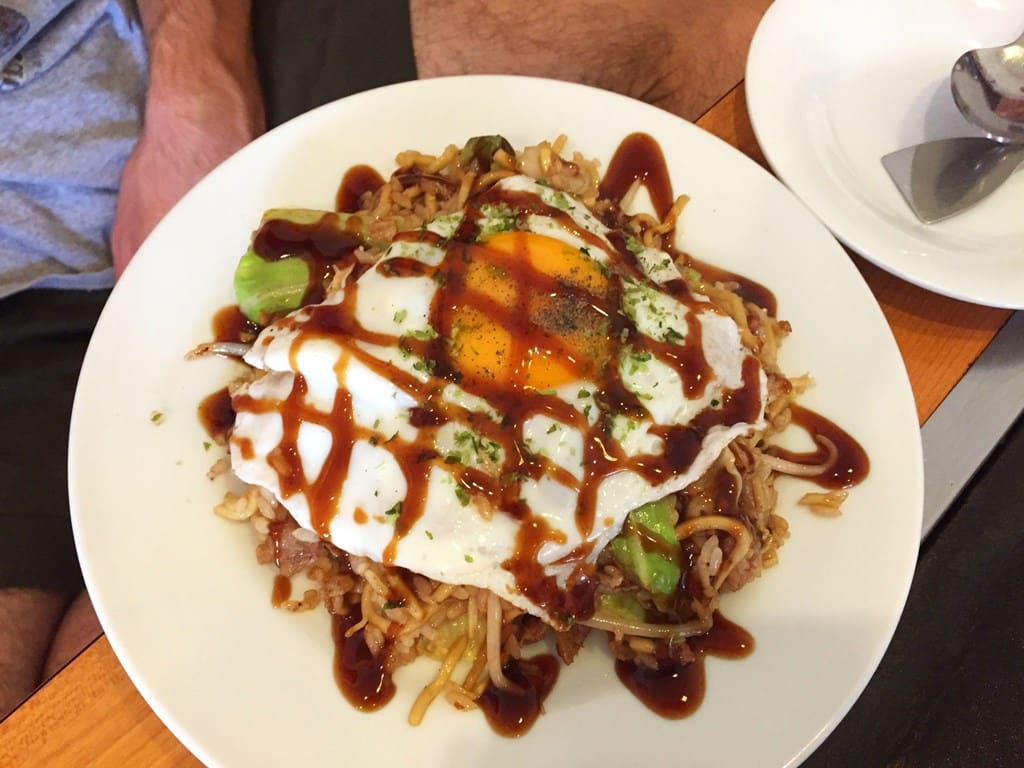 Okonomiyaki with egg on top