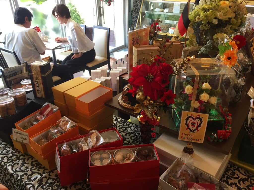 Display of packaged cakes and flowers