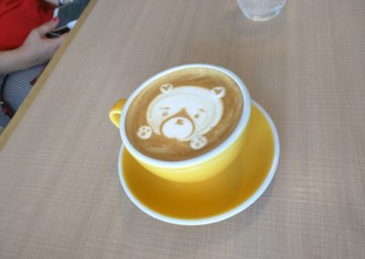 Bear design in cup of coffee