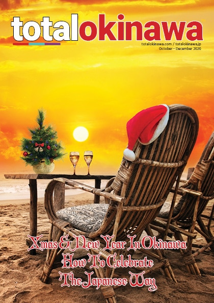 Deckchair on beach with santa hat and two glasses of champagne